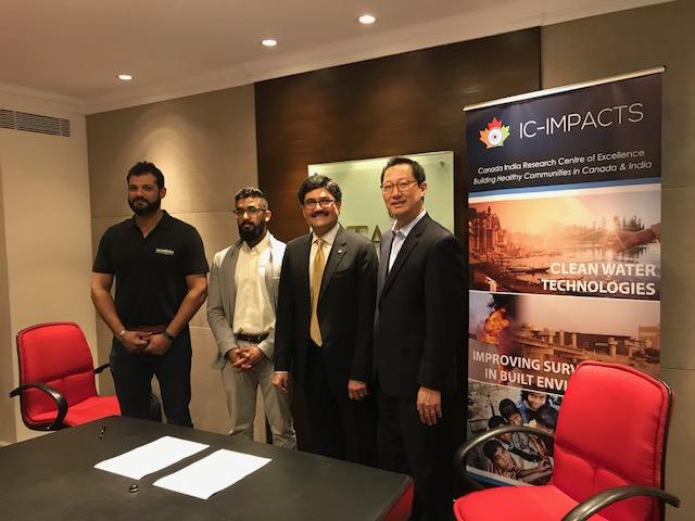 Photo of signatories Danesh Doongaji of SenseIndia, Uzayrabdullah Siddiqui of Starmass, Dr. Nemy Banthia of IC-IMPACTS and UBC President Dr. Santa Ono at Taj Tower Business Center.