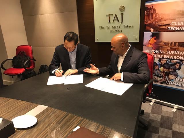 Photo of UBC President Dr. Santa Ono and T-Hub COO Srinivas Kollipara sign statement of cooperation.