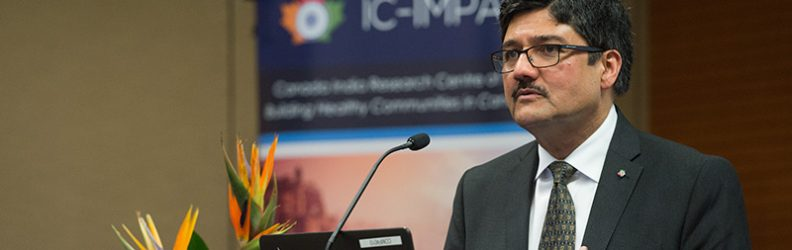 Professor Nemy Banthia pictured at podium during a talk at 2018 IC-IMPACTS Research Conference